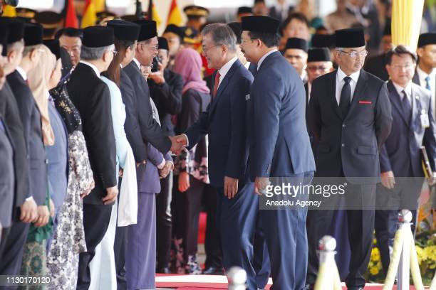 President of South Korea Moon JaeIn shakes hands with eader of Malaysia's People's Justice Party Anwar Ibrahim during a welcoming ceremony at the...