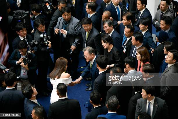 President of South Korea Moon Jaein shakes hands with South Korean actress Ha Jiwon during KWave amp Halal Show In Kuala Lumpur Malaysia on March 12...