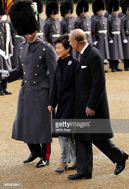 President of South Korea Park GeunHye is accompanied by Prince Philip Duke of Edinburgh to inspect a guard of honour during a ceremonial welcome at...