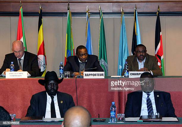 President of South Sudan Salva Kiir Mayardit attends a meeting with Riek Machar AU Commissioner for Peace and Security Ismail Chergui Kenyan...