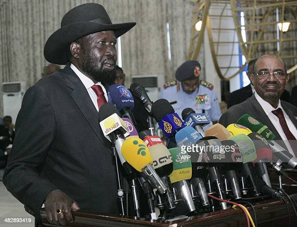 President of South Sudan Salva Kiir speaks to the press before his departure as his Sudanese counterpart Omar alBashir listens on at Khartoum...