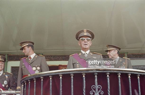 President of Spain General Francisco Franco stands wearing full military dress uniform and sunglasses together with Prince of Spain Juan Carlos de...