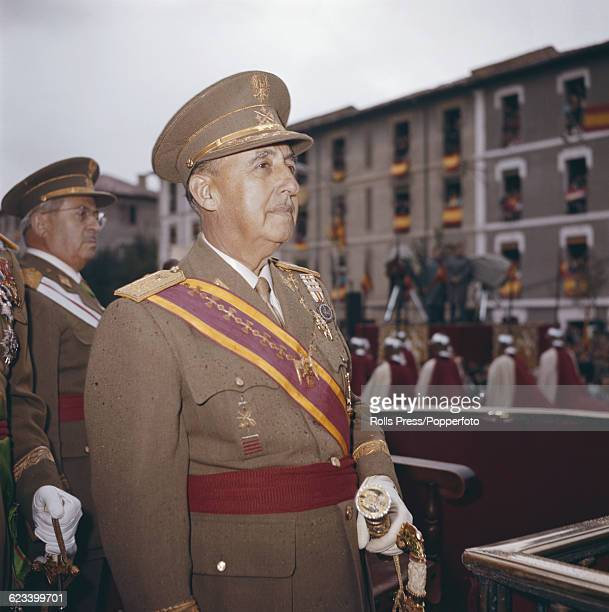 President of Spain General Francisco Franco stands wearing full military dress uniform to observe a parade and march past in Spain in 1969