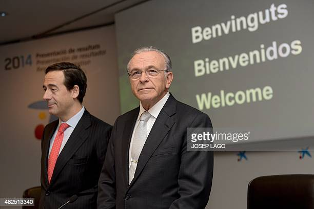 President of Spain's biggest savings bank La Caixa Isidre Faine poses with CaixaBank's Chief Executive Officer Gonzalo Gortazar prior to giving a...