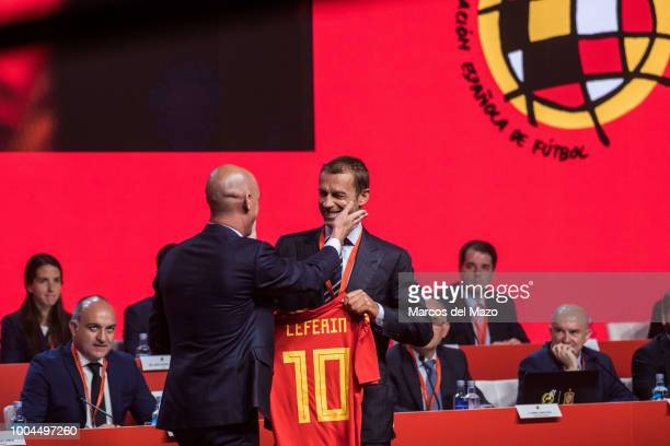 President of Spanish Football Federation Luis Rubiales gives national football shirt to UEFA president Aleksander Ceferin during the RFEF general...