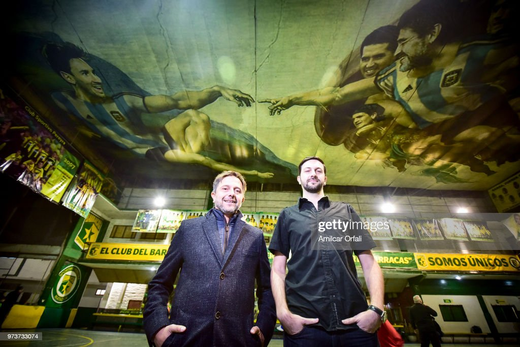 President of Sportivo Pereyra de Barracas Club, Sebastian Garcia (L) and Santiago Barbeito, the artist who created the mural pose on June 13, 2018 in Buenos Aires, Argentina. The mural was painted in the ceiling of the pitch by local artist Santiago Barbeito depiciting the 'Creation of Adam' and making a tribute to Argentin football stars.