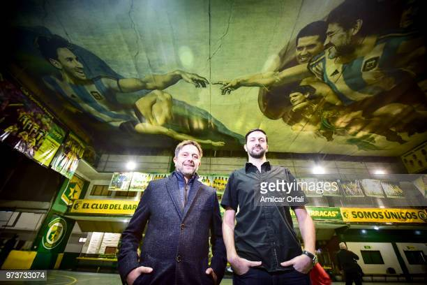 President of Sportivo Pereyra de Barracas Club Sebastian Garcia and Santiago Barbeito the artist who created the mural pose on June 13 2018 in Buenos...