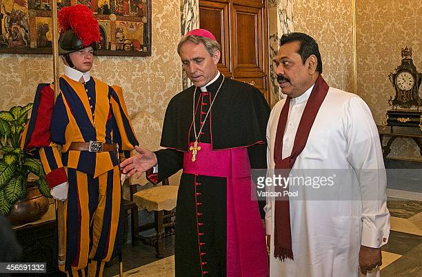 President of Sri Lanka Mahinda Rajapaksa flanked by Prefect of the Pontifical House and former personal secretary of Pope Benedict XVI Georg Ganswein...
