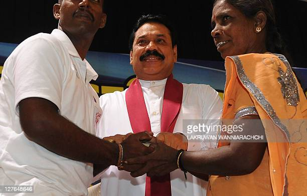 President of Sri Lanka Mahinda Rajapakse reunites a Tamil mother with her exTamil Tiger son in Colombo on September 30 2011 marking the end of the...