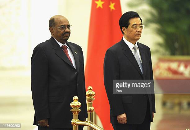 President of Sudan Omar alBashir and Chinese President Hu Jintao listen to the national anthems during a welcoming ceremony at the Great Hall of the...