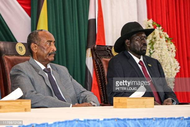 President of Sudanese Transitional Council General Abdel Fattah alBurhan and President of South Sudan Salva Kiir attend a meeting to endorse the...