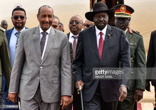 President of Sudanese Transitional Council General Abdel Fattah alBurhan is welcomed by President of South Sudan Salva Kiir at his arrival for the...