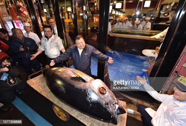 President of sushi restaurant chain SushiZanmai Kiyoshi Kimura displays a 278kg bluefin tuna at his main restaurant in Tokyo on January 5 2019 A...