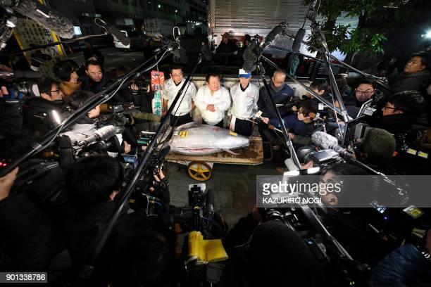 President of sushi restaurant chain SushiZanmai Kiyoshi Kimura displays a 190kilogram bluefin tuna near Tokyo's Tsukiji fish market on January 5 2018...