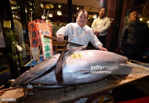TOPSHOT President of sushi restaurant chain SushiZanmai Kiyoshi Kimura displays a 190kilogram bluefin tuna at his main restaurant near Tokyo's...