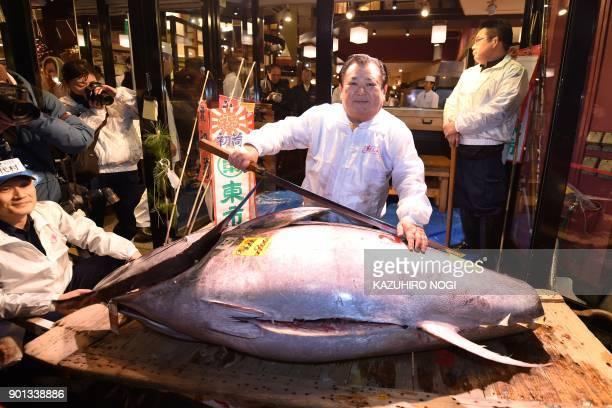 President of sushi restaurant chain SushiZanmai Kiyoshi Kimura displays a 190kilogram bluefin tuna at his main restaurant near Tokyo's Tsukiji fish...