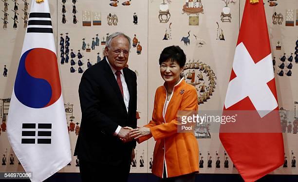 President of Switzerland Johann Schneider-Ammann shakes hands with South Korea's President Park Geun-Hye at the presidential blue house on July 13,...