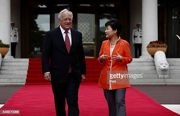 President of Switzerland Johann Schneider-Ammann talks with South Korea's President Park Geun-Hye as he arrive at the presidential blue house on July...
