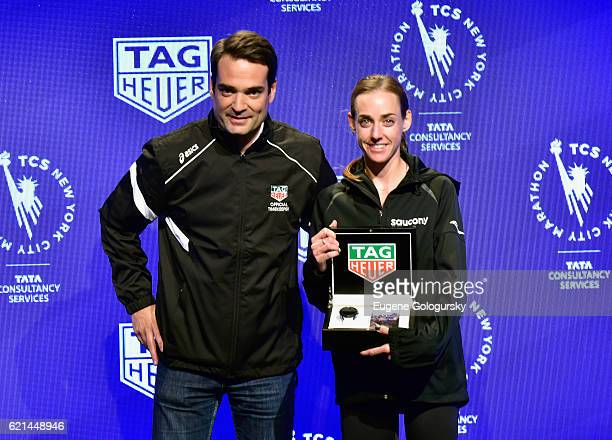 President of TAG Heuer North America Kilian Mueller presents a TAG Heuer Connected Watch to Molly Huddle, top American finisher with TAG Heuer...