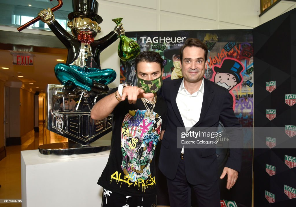 President of Tag Heuer North America Kilian Muller (R) celebrates Fontainebleau Hotel Art Takeover With TAG Heuer Art Provocateur Alec Monopoly at Miami Design District on December 7, 2017 in Miami, Florida.