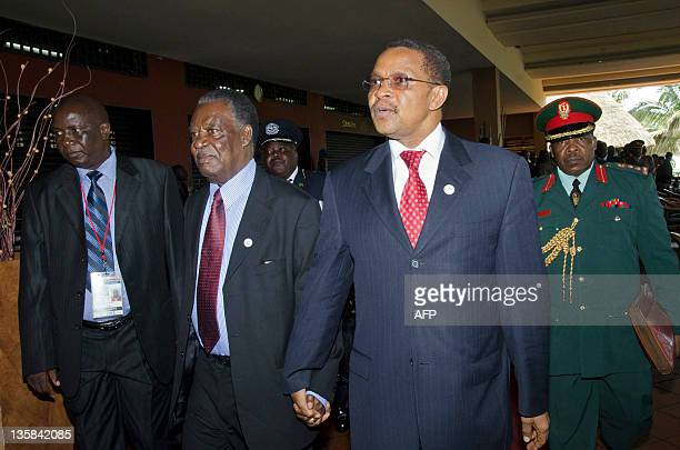 President of Tanzania Jakaya Kywete walks holding hands with Zambian President Michael Sata at the International Conference of the Great Lakes region...