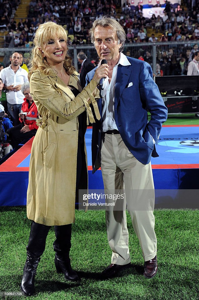 President of Telethon Luca Cordero di Montezemolo (R) and Milly Carlucci attend the XIX Partita Del Cuore charity football game at on May 25, 2010 in Modena, Italy.