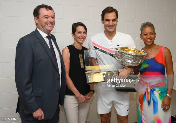 President of Tennis Australia Jayne Hrdlicka presents Roger Federer of Switzerland a special RF20 trophy on day 14 of the 2018 Australian Open at...