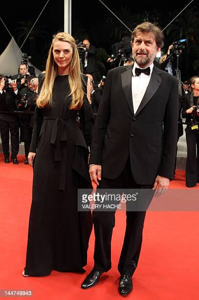 President of the 65th Cannes Film Festival jury Nanni Moretti and Chiara Palmieri arrive for the screening of Reality presented in competition at the...