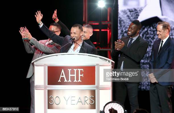 President of the AIDS Healthcare Foundation Michael Weinstein Kevin Pakdivichit AJ Alegria Jose Ramos and Rig Rush speak onstage during the AHF World...