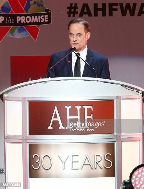 President of the AIDS Healthcare Foundation Michael Weinstein speaks onstage during the AHF World AIDS DAY Concert and 30th Anniversary Celebration...