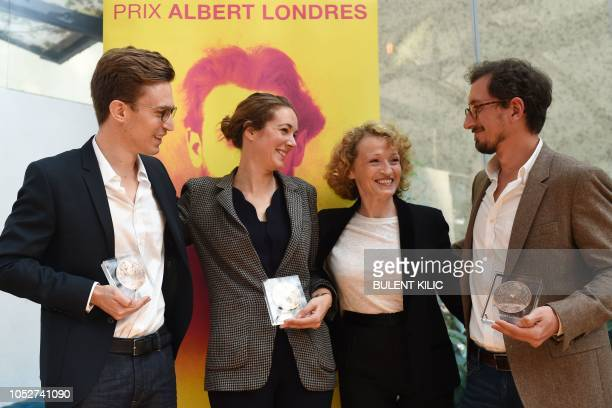 President of the Albert Londres Prize jury Annick Cojean poses with winners of the Albert Londres prize French journalists Elise Vincent JeanBaptiste...