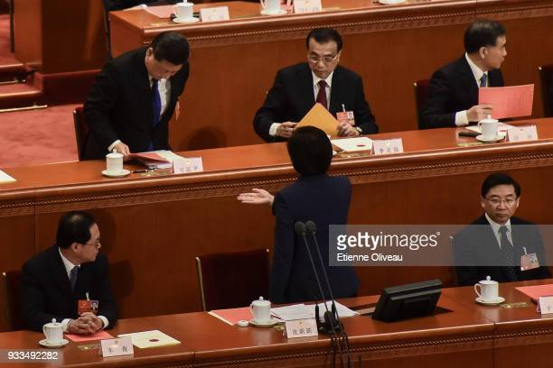 President of the All China Women's Federation Shen Yueyue asks Chinese President Xi Jinping and Chinese Premier Li Keqiang to cast their ballots...