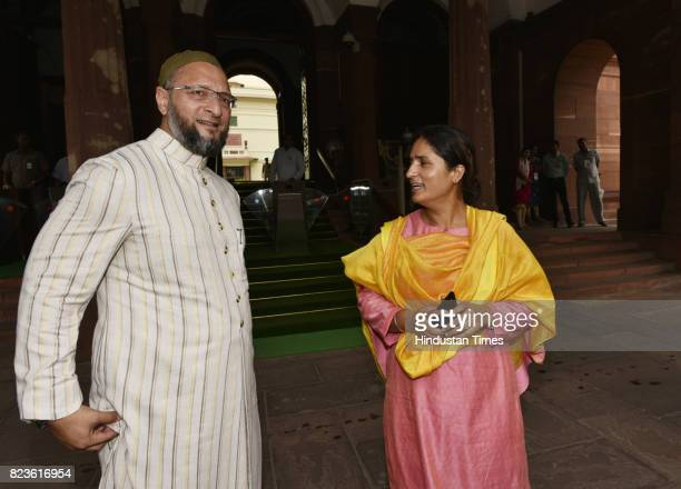 President of the All India MajliseIttehadul Muslimeen Asaduddin Owaisi talking to Congress MP from Supaul Bihar Ranjeet Ranjan at the Parliament...