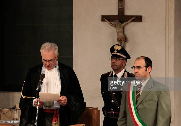 President of the appeal court Claudio Pratillo Hellmann reads the verdict during the appeal trial session at the Perugia court on October 3, 2011 in...