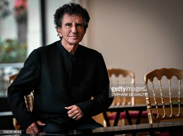 President of the Arab World Institute and former French Culture minister and founder of the 'Fete de la Musique' Jack Lang attends a tea ceremony...