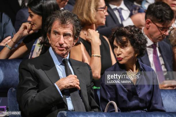 President of the Arab World Institute former french Culture minister and founder of the 'Fete de la Musique' Jack Lang speaks with his wife Monique...