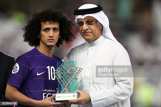 President of the Asian Football Confederation Shaikh Salman bin Ebrahim Al Khalifa presents AlAin's midfielder Omar Abdulrahman with the man of the...