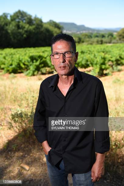 """President of the association """"Coordination Harka"""", Hacene Arfi, poses, on June 30, 2020 in Saint-Laurent-des-Arbres, southern France, next to of one..."""