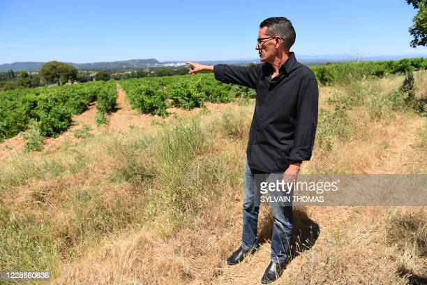 """President of the association """"Coordination Harka"""", Hacene Arfi, shows, on June 30, 2020 in Saint-Laurent-des-Arbres, southern France, one of the two..."""