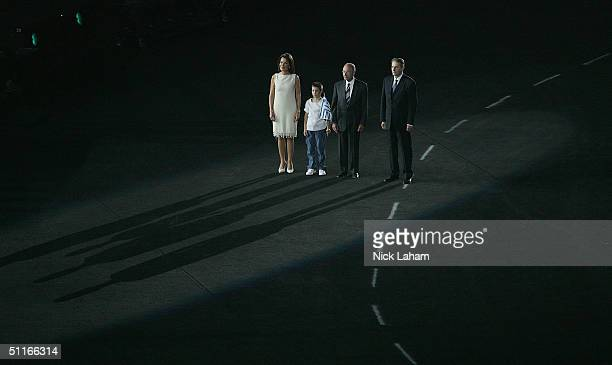 President of the Athens Organizing Committee Gianna Angelopoulos-Daskalaki, child performer Michalis Patsatzis, Greek President Constantinos...