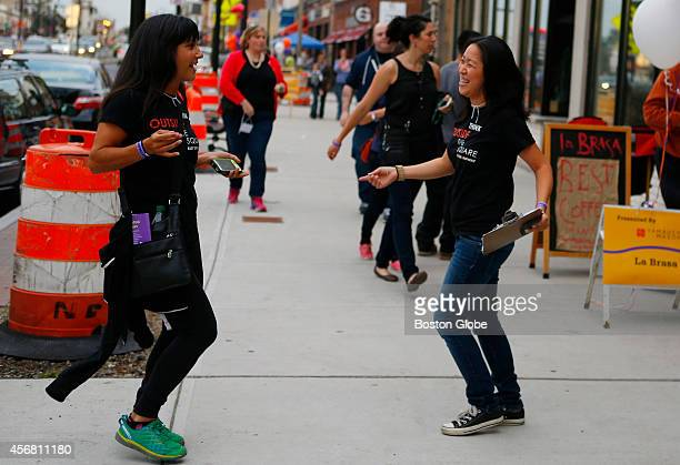 President of the Board of East Somerville Main Streets Renee Polcaro left and Foodie Crawl Chair Evelyn Yamauchi right dance to Radio Mambo as they...