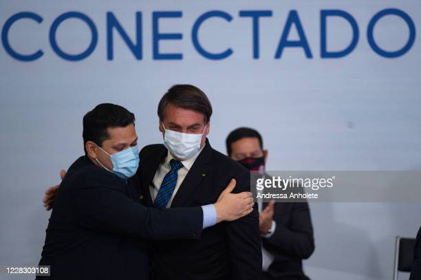 President of the Brazil Senate Davi Alcolumbre embraces President of Brazil Jair Bolsonaro during launch of the Programa Norte Conectado amidst the...