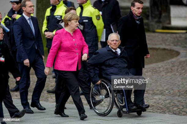 President of the Bundesrat and mayor of Berlin Michael Mueller German Chancellor Angela Merkel and President of the Bundestag Wolfgang Schaeuble...