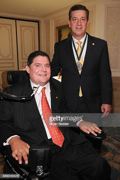 President of the Buoniconti Fund Marc Buoniconti and Bill Simonattend the 29th Annual Great Sports Legends Dinner to benefit The Buoniconti Fund to...