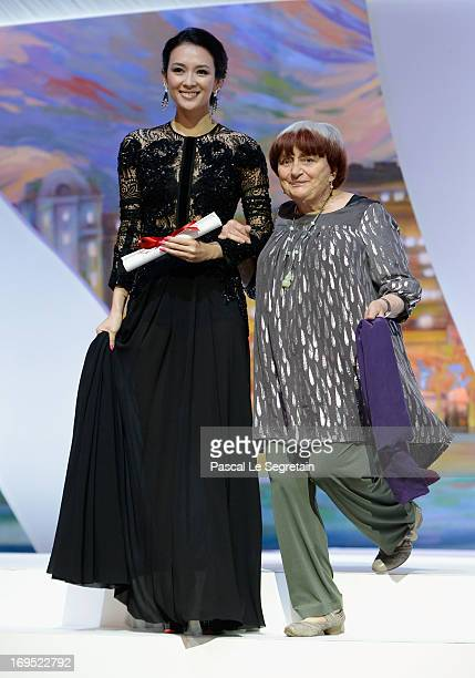 President of the Camera d'Or jury Agnes Varda and 'Un Certain Regard' jury member Zhang Ziyi walk onto the stage during the Closing Ceremony during...