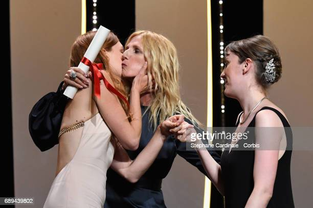 President of the Camera d'Or jury Sandrine Kiberlain greets actress Laetitia Dosch while awarding director Leonor Serraille with the Camera d'Or for...