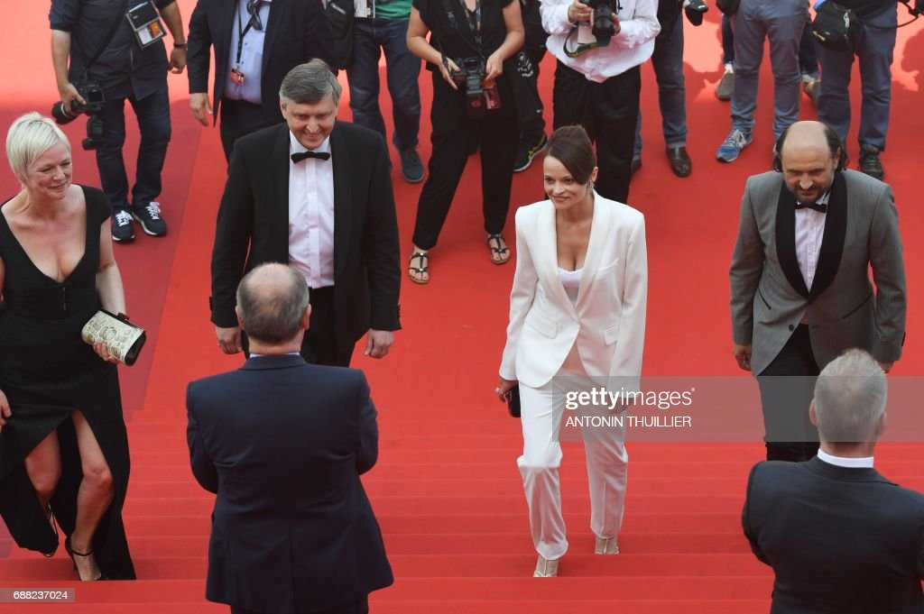 President of the Cannes Film Festival Pierre Lescure (Front L) and General Delegate of the Cannes Film Festival Thierry Fremaux (Front R) greet (From L) Danish producer Marianne Slot, Russian director Sergei Loznitsa, actress Vasilina Makovtseva and Moldovan actor Valeriu Andriuta as they arrive on May 25, 2017 for the screening of the film 'Krotkaya' (A Gentle Creature) at the 70th edition of the Cannes Film Festival in Cannes, southern France. / AFP PHOTO / Antonin THUILLIER