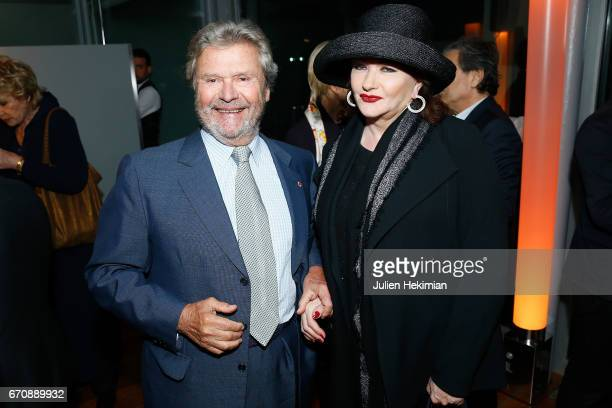 President of the Cartier Fondation Alain Dominique Perrin and French actress Catherine Jacob attend 'Auto Photo' Exhibition Preview at Fondation...