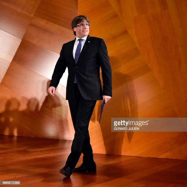 President of the Catalan government Carles Puigdemont arrives at the Madrid City Hall in the Cibeles palace to take part in the conference 'A...