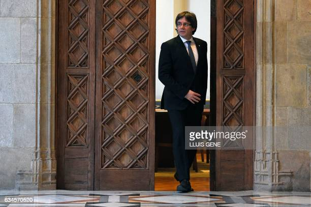 President of the Catalan Government Carles Puigdemont leaves his office to receive former President of the Catalan Government and leader of Partit...